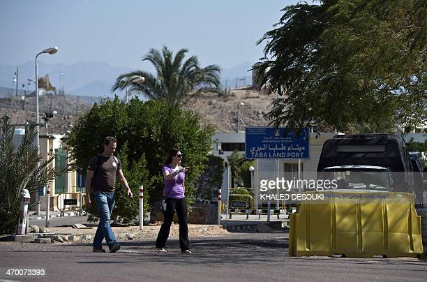Tourists arrive in Egypt after crossing the Taba Land Port on February 18 two days after a tourist bus exploded in the Egyptian south Sinai resort...