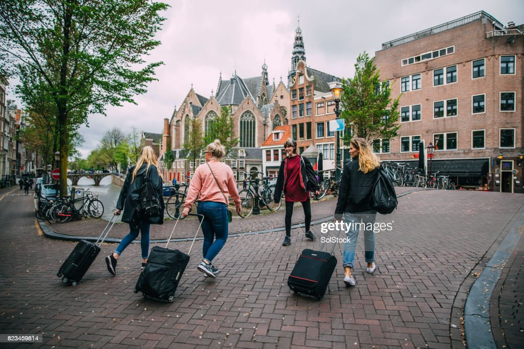 Tourists Arriving in Amsterdam : Stock Photo