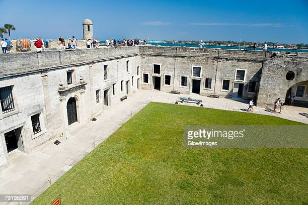 tourists at a castle, castillo de san marcos national monument, st. augustine, florida, usa - st. augustine florida stock photos and pictures