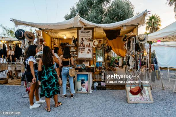 Tourists at a stall in Las Dalias Hippy market.