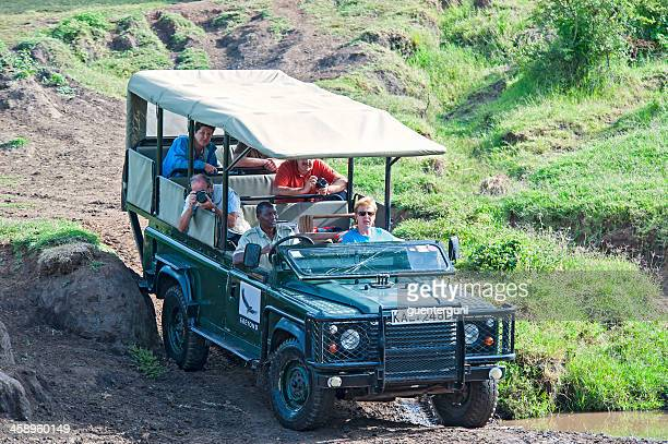 tourists at an wildlife safari in masai mara, kenya - land rover stock pictures, royalty-free photos & images