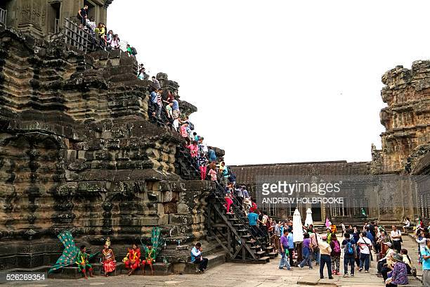 Tourists at Angkor Wat a UNESCO World Heritage site and the largest religious monument in the world It was originally constructed as a Hindu temple...