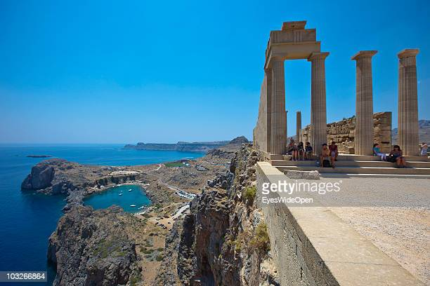 JUlLY 04: Tourists at Athena-Lindia-Temple at the Acropolis of Lindos on July 04, 2010 in Lindos, Greece. The old town of Lindos is famous for the...