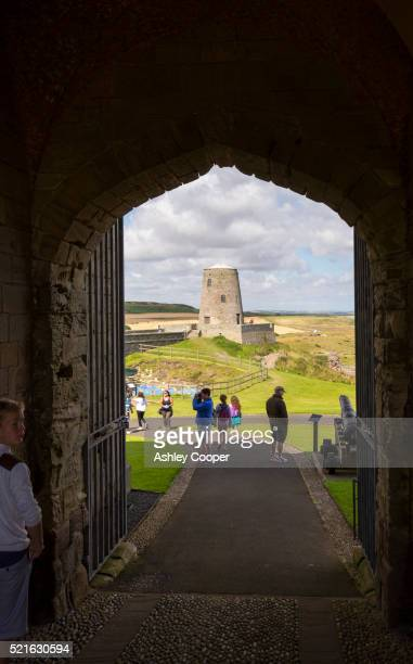 Tourists at Bamburgh Castle in Northumberland, UK.
