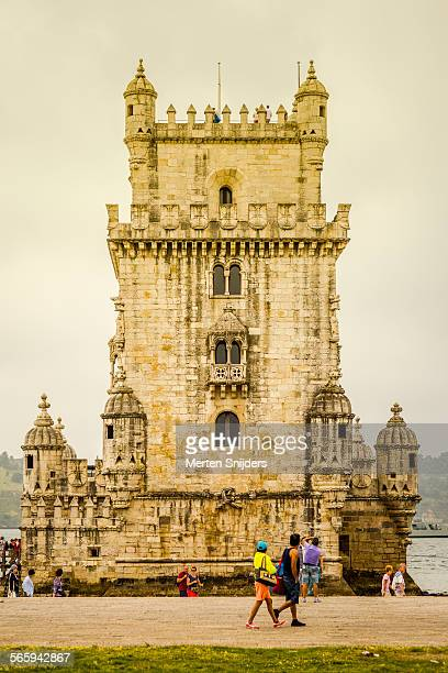 tourists at belém tower - merten snijders stock pictures, royalty-free photos & images