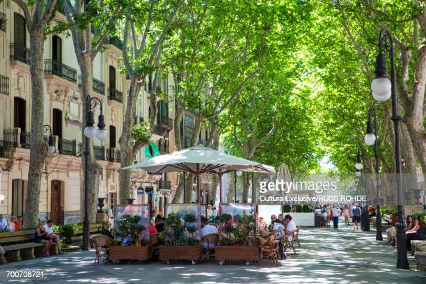 tourists at boulevard restaurants and bars, palma de mallorca, majorca, spain - palma majorca stock photos and pictures