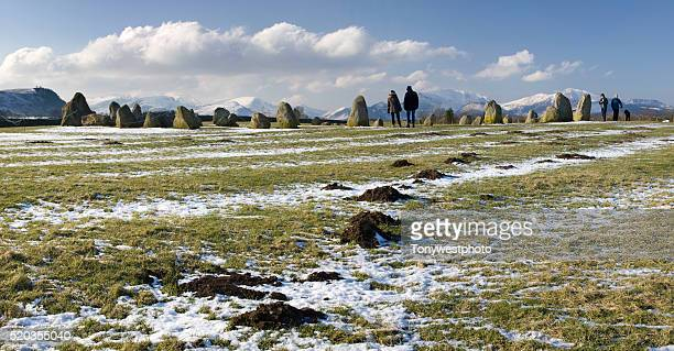 tourists at castlerigg stone circle in the english lake district - ケズイック ストックフォトと画像