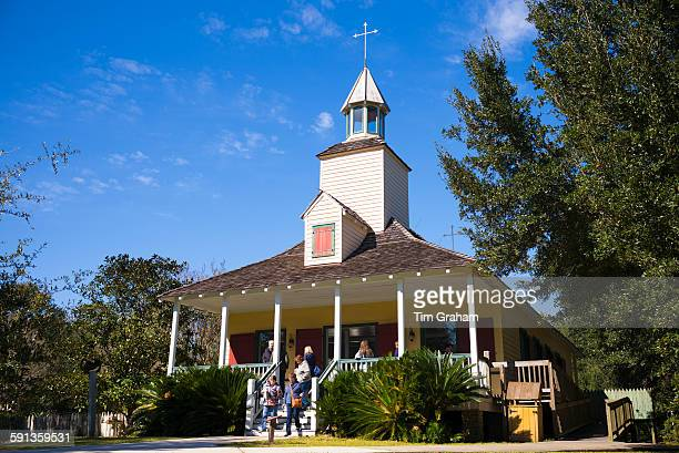 Tourists at Church at Vermilionville living history museum of Acadian Creole and Native American culture Louisiana USA