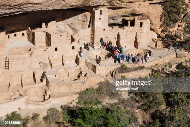 Tourists at Cliff Palace at Mesa Verde National Park in Colorado, United States