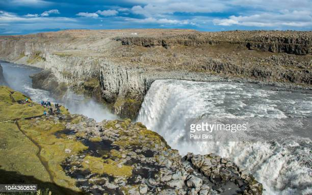 tourists at detifoss falls in iceland - dettifoss waterfall stock photos and pictures
