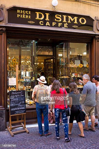 Tourists at Di Simo Caffe in Via Fillungo Lucca Italy