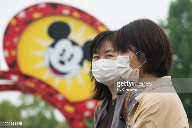 Tourists at Disney town on May 05 2020 in Shanghai China After decades of growth officials said Chinas economy had shrunk in the latest quarter due...