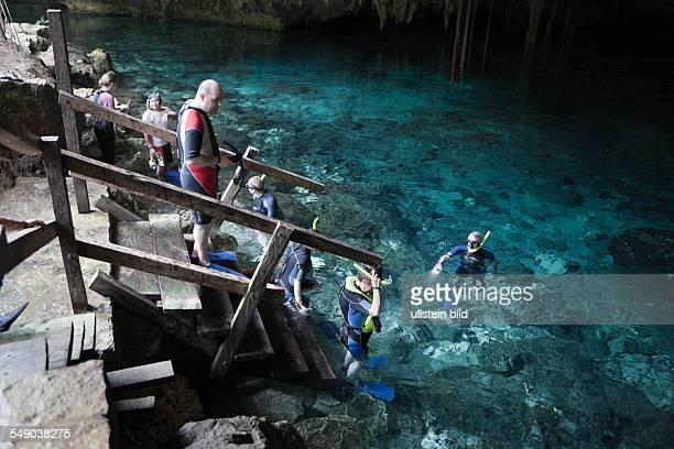 Tourists at Dos Ojos Cenote Playa del Carmen Yucatan Peninsula Mexico