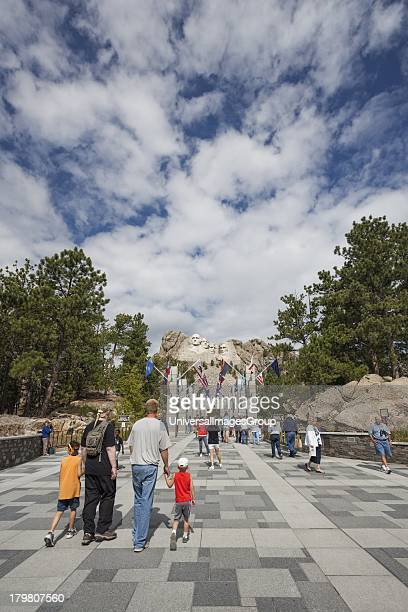 Tourists at Entrance to Mount Rushmore National Memorial, Black Hills, South Dakota.