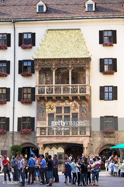 Tourists at Goldenes Dachl Golden Roof built 1500 of gilded copper in Herzog Friedrich Strasse Innsbruck the Tyrol Austria