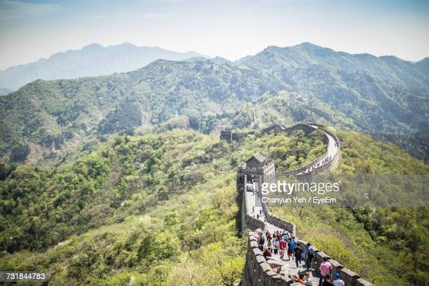 Tourists At Great Wall Of China Amidst Trees On Mountain