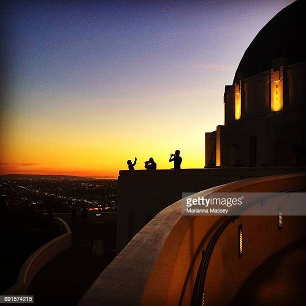 tourists at griffin observatory - griffith park stock pictures, royalty-free photos & images