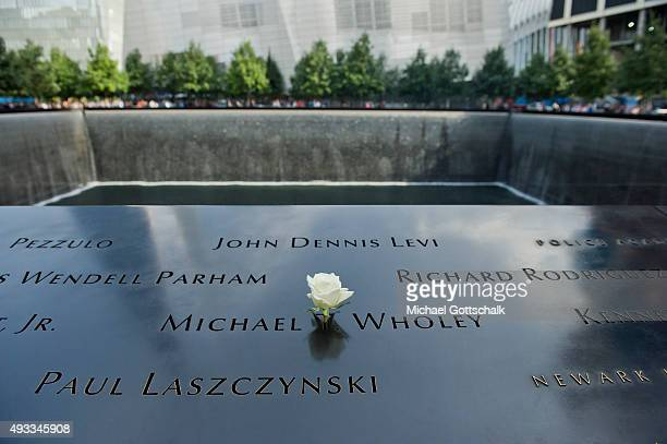 Tourists at Ground Zero memorial on September 26 2015 in New York United States