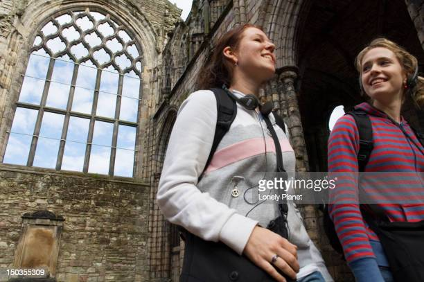 Tourists at Holyrood Abbey at Palace of Holyroodhouse, Holyrood district.