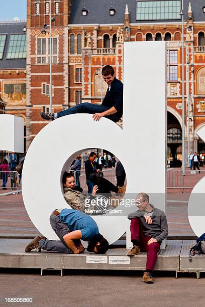 tourists at iamsterdam sign - letter d stock pictures, royalty-free photos & images