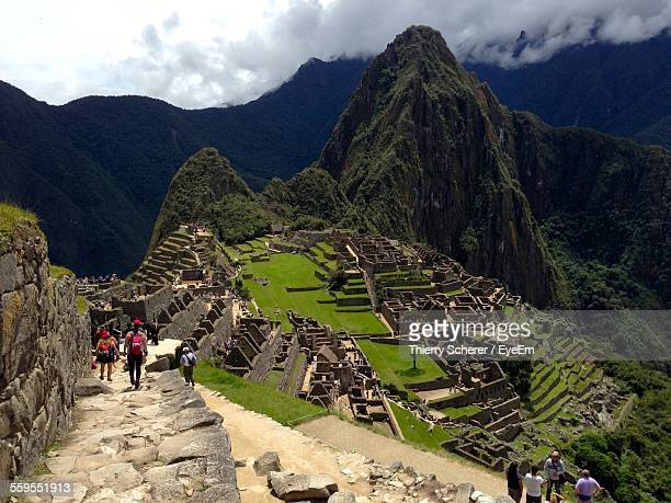 Tourists At Machu Picchu Against Sky