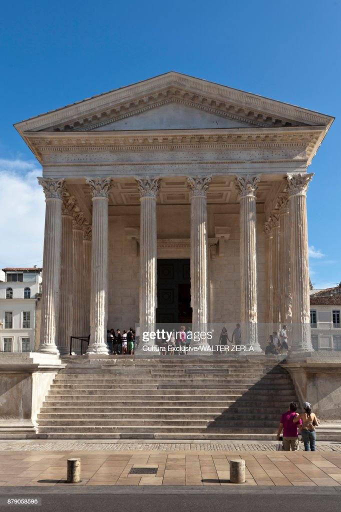 Tourists at maison carree nimes languedocroussillon france - Maison carree nimes ...