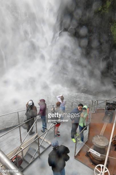 Tourists at Milford Sound in Fiordland National Park, New Zealand