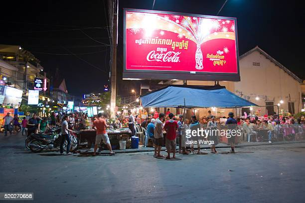 tourists at night food stalls, siem reap, cambodia - jake warga stock pictures, royalty-free photos & images