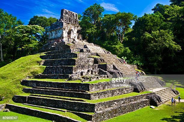 Tourists at old ruins of a temple, Templo De La Cruz, Palenque, Chiapas, Mexico