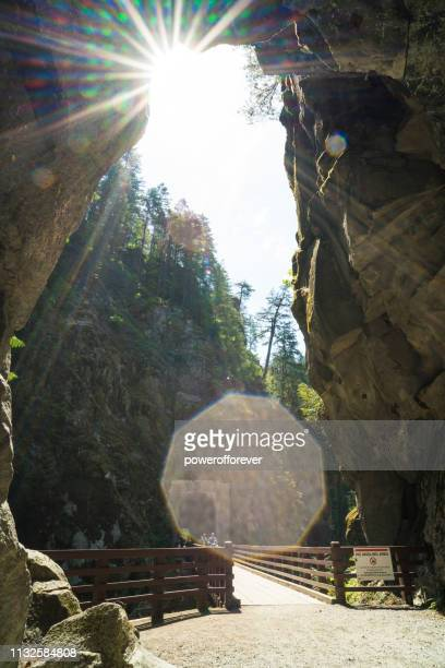 Tourists at Othello Tunnels at Coquihalla Canyon Provincial Park in the Canadian Rocky Mountains of British Columbia, Canada