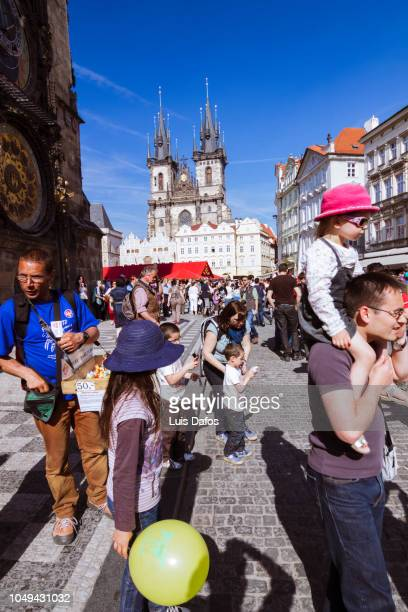 tourists at prague old town square - dafos stock photos and pictures