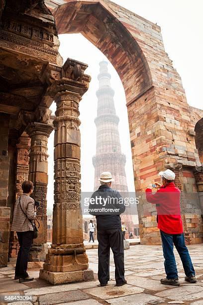Tourists at Qutb Minar in New Delhi, India.