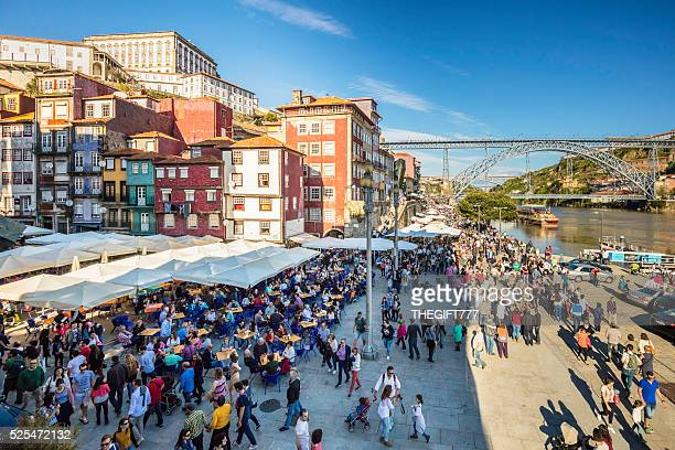 tourists at river douro with dom luis i bridge - porto portugal stock pictures, royalty-free photos & images