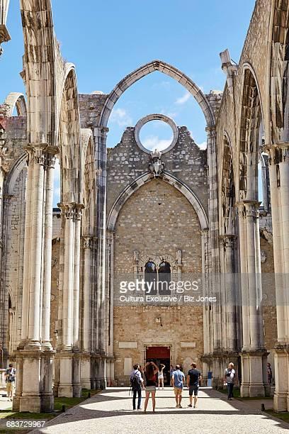 Tourists at ruins of Carmo Convent (Convento da Ordem do Carmo) in Lisbon, Portugal
