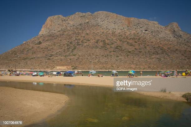 Tourists at Stavros beach which is located on the northern side of Akrotiri in Crete Island