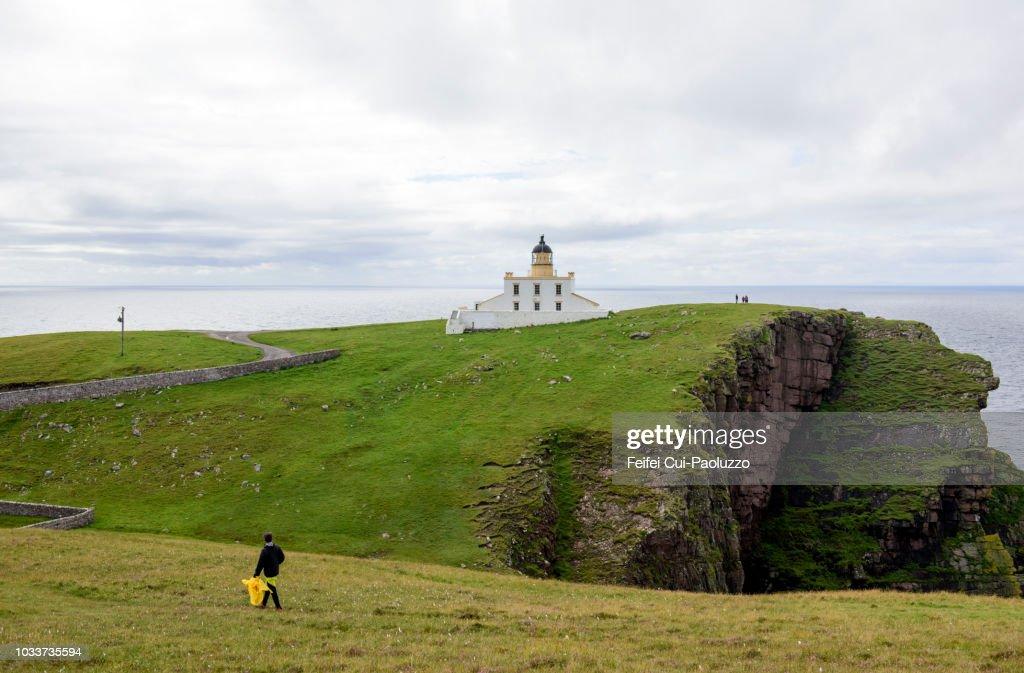 Tourists at Stoer Head Lighthouse, Scotland : Stock Photo