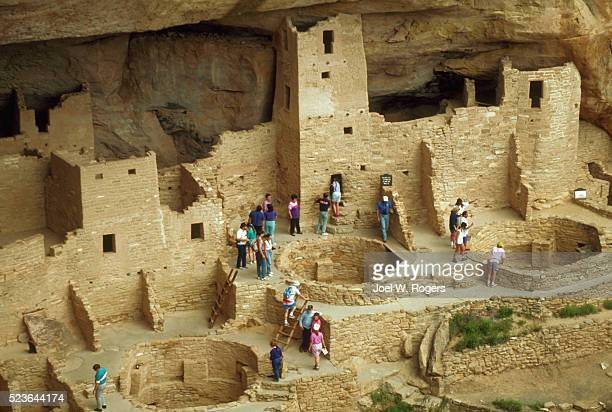 tourists at the anasazi cliff dwellings - mesa verde national park stock pictures, royalty-free photos & images