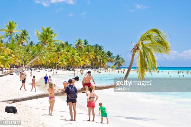 Tourists at the beach of Isla Saona in Dominican Republic