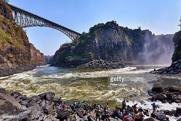 tourists at the boiling pot lookout - victoria falls stock pictures, royalty-free photos & images