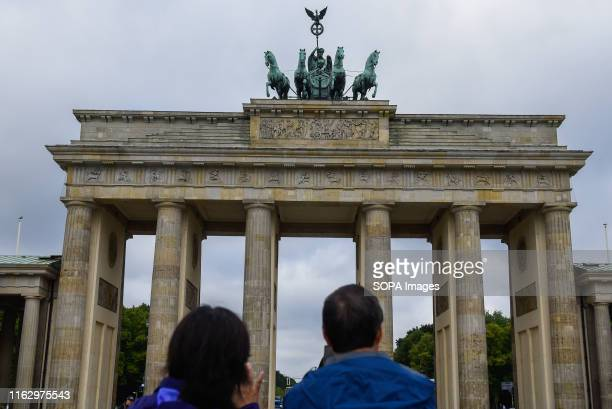 Tourists at the Brandenburg Gate in Berlin.