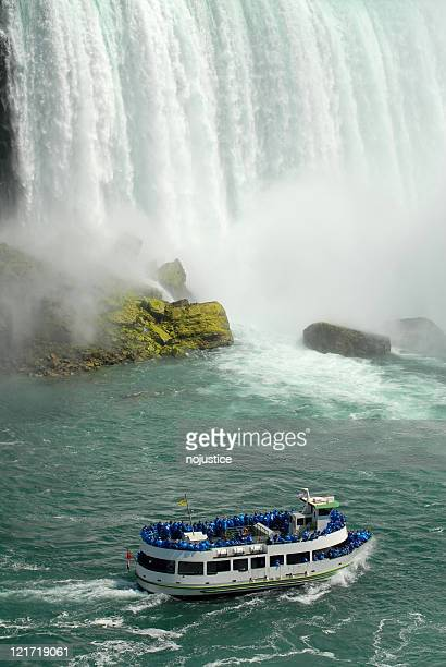 tourists at the foot of niagara - niagara river stock pictures, royalty-free photos & images