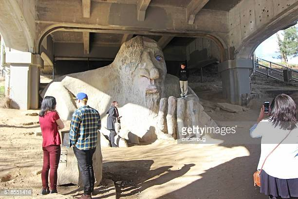 tourists at the fremont troll - seattle, washington - troll stock photos and pictures