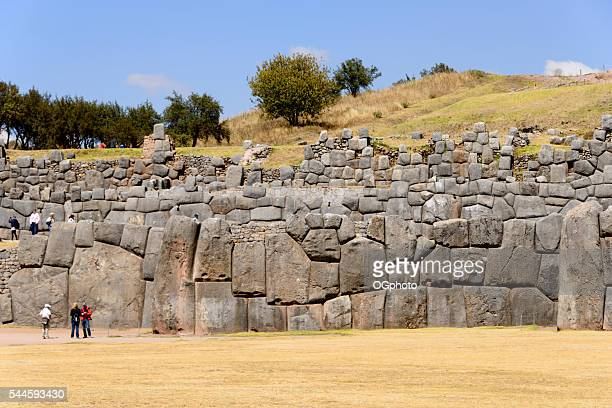 tourists at the incan archaelogical site of saqsaywaman, cusco, peru - ogphoto stock pictures, royalty-free photos & images