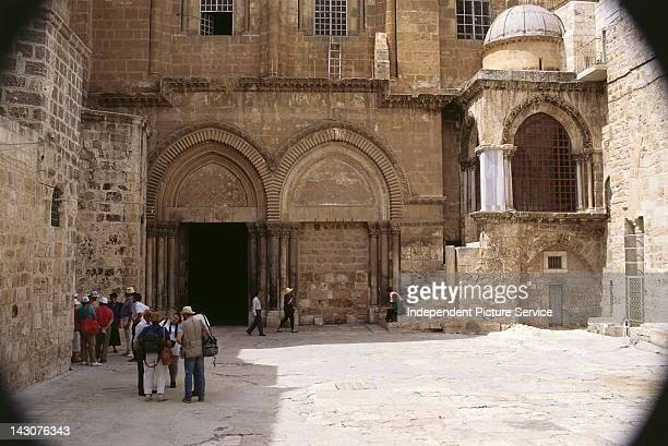 Tourists at the main entrance to the Church of the HolySepulchre Jerusalem