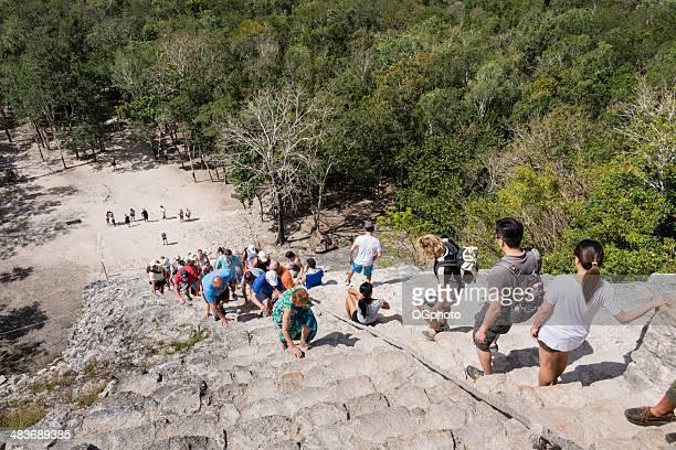 tourists at the mayan pyramid at coba -xxxl - ogphoto bildbanksfoton och bilder