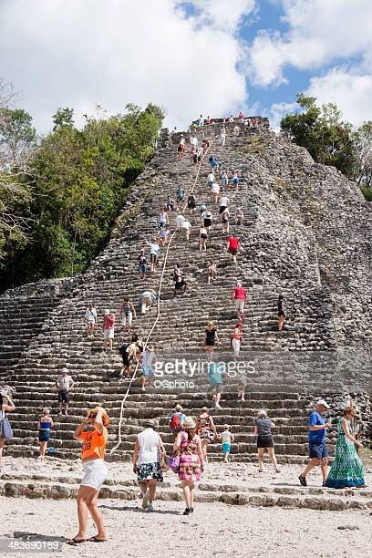 tourists at the mayan pyramid at coba -xxxl - ogphoto stock photos and pictures