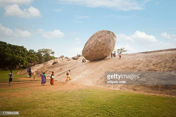 Tourists at the monument of Krishnas Butter Ball, Mahabalipuram, Kanchipuram District, Tamil Nadu, India
