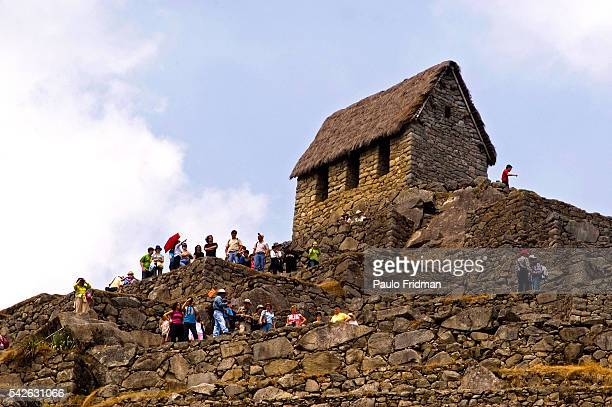 Tourists at the ruins of Machu Picchu