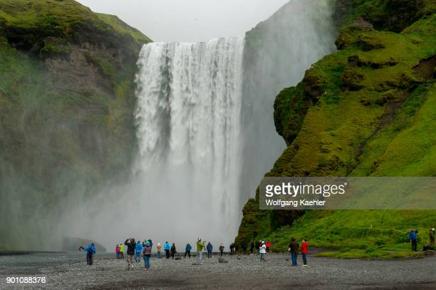 Tourists at the Skogafoss which is one of the biggest waterfalls in southern Iceland with a width of 15 meters and a drop of 60 m