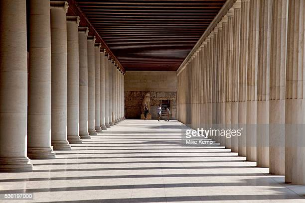 Tourists at The Stoa of Attalos or Attalus located in the east side of archaeological site of the Ancient Agora in Athens just oposite the Adrianou...